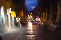 Night traffic in the old part of Rome, Italy Stock Images