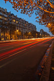 Night traffic on a Parisian street Stock Images