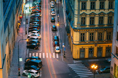 Night Traffic and parked cars on the Hybernska street in Prague Royalty Free Stock Image