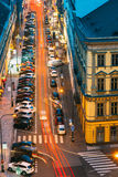 Night Traffic and parked cars on the Hybernska street in Prague, Royalty Free Stock Images