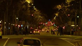 Night traffic, people crossing wide street in the city, evening atmosphere. Stock footage stock video