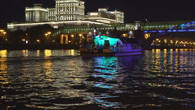 Night traffic of pleasure boats on a city river stock footage