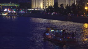 Night traffic of pleasure boats on a city river stock video