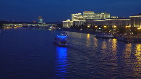 Night traffic of pleasure boats on a city river stock video footage