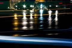 Rainy night traffic in front of tunnel royalty free stock images