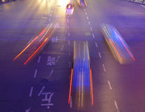 Night traffic in Shanghai. China. Cars in motion blur taking different directions Stock Photography