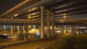 Night traffic on the urban thoroughfare,overpass,   and road junction. Night traffic on the urban thoroughfare,overpass, and road junction, Moscow stock footage