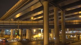 Night traffic on the urban thoroughfare,overpass,   and road junction. Night traffic on the urban thoroughfare,overpass, and road junction, n Moscow stock footage