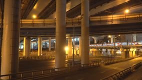 Night traffic on the urban thoroughfare,overpass,   and road junction. Night traffic on the urban thoroughfare,overpass, and road junction, n Moscow stock video