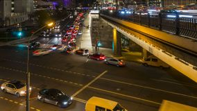 Night traffic on the urban thoroughfare   and road junction. Moscow stock video footage