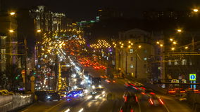 Night traffic on urban thoroughfare. Time lapse stock video