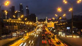 Night traffic on urban thoroughfare. Time lapse stock footage