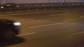 Night traffic on the urban thoroughfare  tunnel and road junction. Moscow stock video
