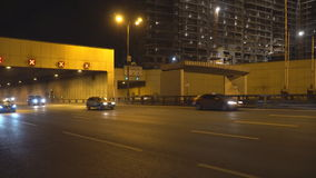 Night traffic on the urban thoroughfare  tunnel and road junction. Moscow stock video footage