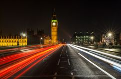 Night Traffic on Westminster Bridge By Big Ben, London, England. Light Trails of cars and traffic on Westminster Bridge, London at Night with The Houses of Royalty Free Stock Images
