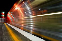 Night Train. Long exposure of a passing passenger train at night Royalty Free Stock Image