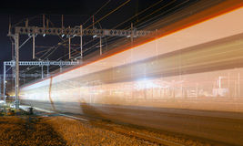 Night Train Blur. An image of a night train in motion with electric overheads vector illustration