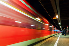 Night train of Deutsche Bahn at a station in Cologne Stock Photos