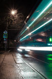 Night train lights. Photo of a night tram at a long exposure Stock Photography