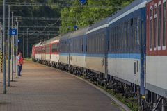 Night train with sleeping coaches and car motorcycle coaches Kysak station. Night train with sleeping coaches and car and motorcycle coaches in Kysak station in stock images