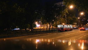 Night tram on the city street stock video footage