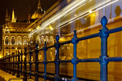 Night tram heading the Parliament Building, Budapest, Hungary Royalty Free Stock Photography