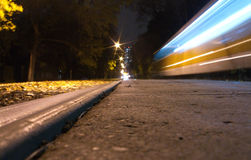 Night tram moves fast Stock Photos