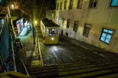 Night tram on a street of Bairro Alto in Lisbon Royalty Free Stock Images