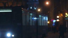Night tram transport lantern in snow bus. Sultanahmet in Winter. A busy winter night old Street stock footage