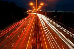 Night travel. Trailing lights from cars on a busy motorway in England Royalty Free Stock Photography