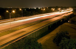 Night Travelers. A busy six lane highway taken at night using time-lapse photography Royalty Free Stock Photo