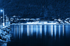 Night Tromso city pier with lamp reflections background. Hd Stock Image