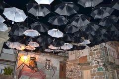 Night umbrellas Stock Images