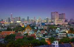 Night Urban City Skyline, Temple in the heart of Bangkok, Thailand. Stock Photo