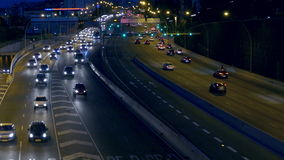 Night urban traffic scene.BARCELONA. Night urban traffic scene with a top and rear view access roads to Barcelona stock footage