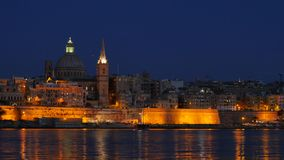 Night Valletta with Carmelite church view and floating yacht hyperlapse stock footage
