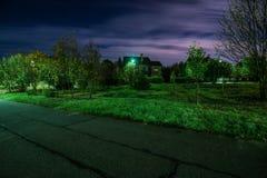 Night in village. Night and light in the village garden stock photos
