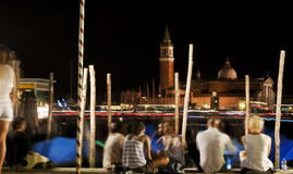 Night in Venice. Some people while waiting for the fireworks of the Redentore's feast in Venice Stock Image