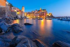 Night Vernazza, Cinque Terre, Liguria, Italy. Night fishing village Vernazza with Santa Margherita di Antiochia Church and lookout tower of Doria Castle, Five stock photo