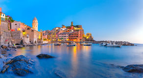 Night Vernazza, Cinque Terre, Liguria, Italy. Panorama of night fishing village Vernazza with Santa Margherita di Antiochia Church and lookout tower of Doria royalty free stock photography