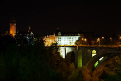Night view of Adolphe Bridge, State Saving Bank. Night view of Adolphe Bridge, Pont Adolphe and State Saving Bank Building and The Banque et Caisse d'Epargne de Stock Photo