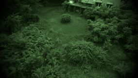 Night view aerial old abandoned scary farm house Stock Photos