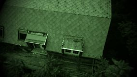 Night view aerial view of old abandoned scary farm house Stock Photo