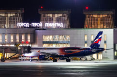 Night view of the airport and the plane of the airline Aeroflot. Russia, Saint-Petersburg April 2017. Stock Image