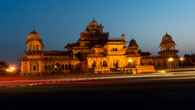Night view Albert Hall museum Jaipur. Light streams from traffic on the busy road in front of the Royal Albert hall museum in Jaipur. The museum is situated in Stock Image