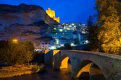 Night view of Alcala del Jucar with castle  and bridge Stock Photography
