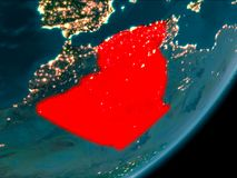 Algeria from space at night. Night view of Algeria highlighted in red on planet Earth with atmosphere. 3D illustration. Elements of this image furnished by NASA Royalty Free Stock Image