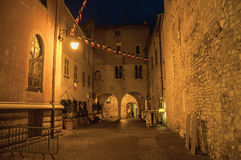 Night view of alley with walls and stone arches in Vence. Royalty Free Stock Photos