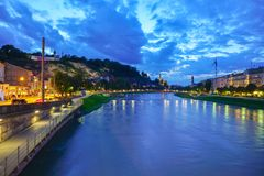 Night view along Salzach River in long exposure dark cloudy sky Royalty Free Stock Images
