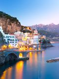 Night view of Amalfi on coast line of mediterranean sea, Italy. Night view of Amalfi cityscape on coast line of mediterranean sea, Italy Stock Photos